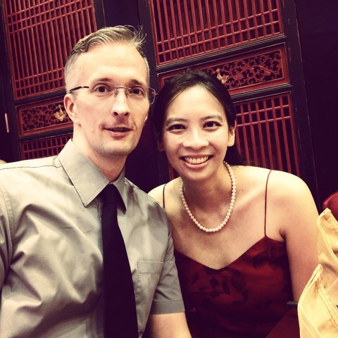 Cindy and her husband at a Chinese wedding